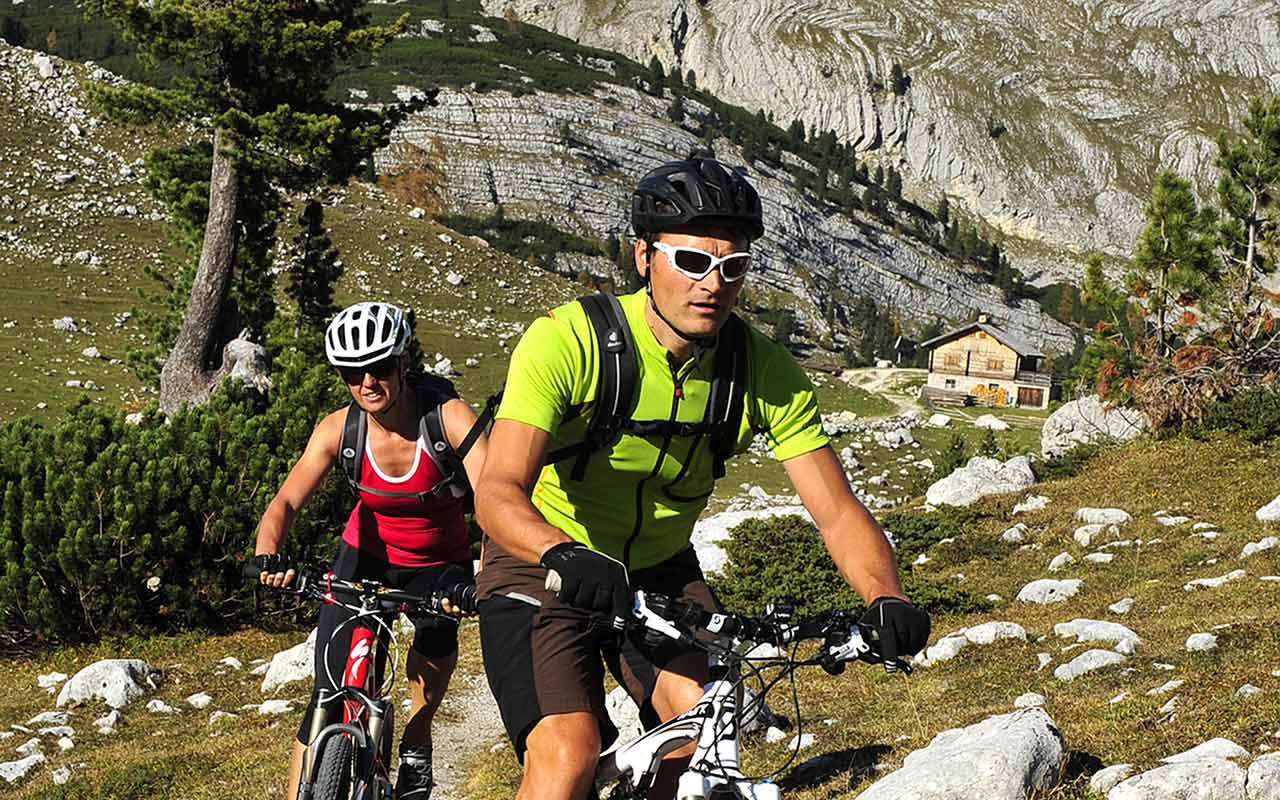 A couple during a mountain bike excursion in the Dolomites
