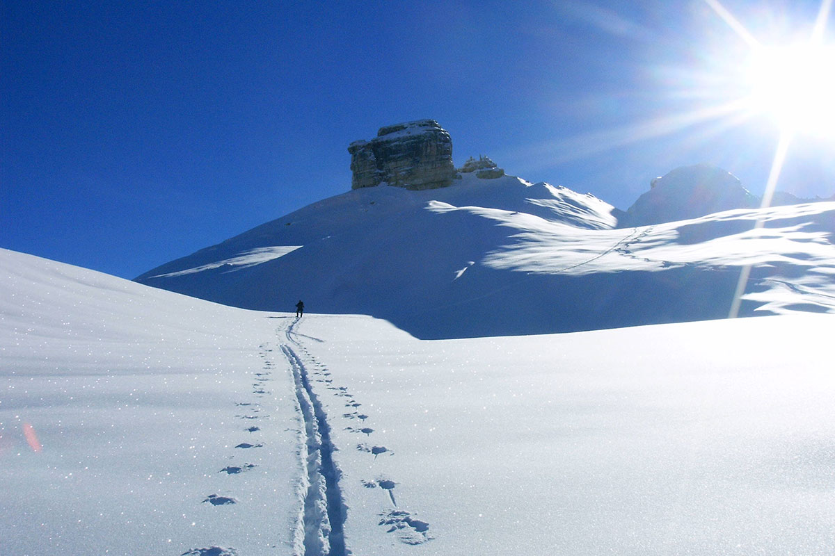 A man on a snow hike around the Fanes Hut