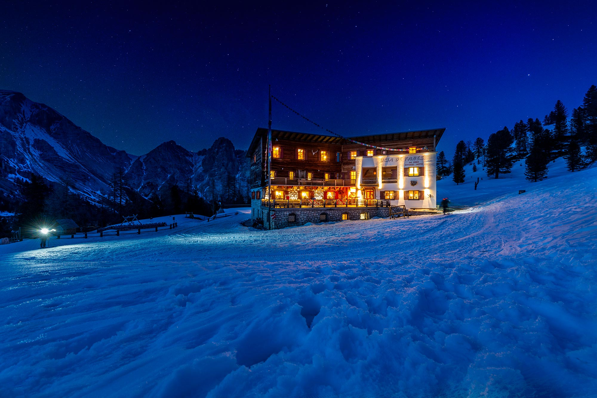 The facade of the Fanes Hut at night during the winter